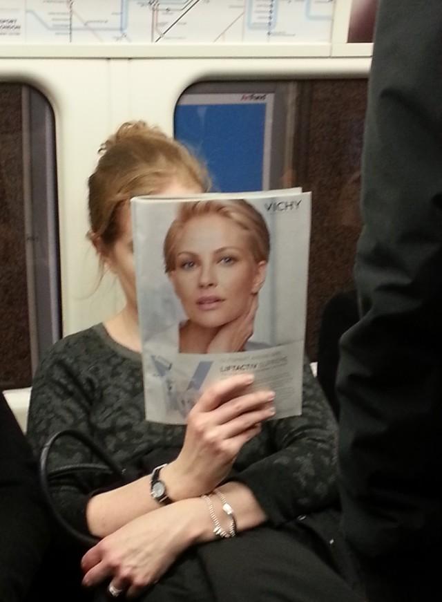 Woman reading Women's Magazine on the Underground