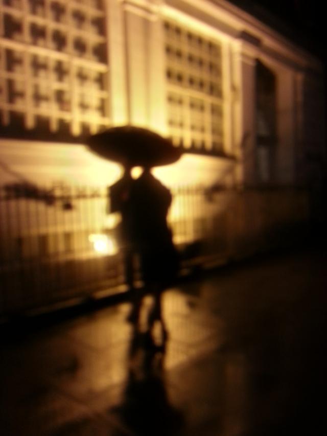 Sharing an umbrella in rain