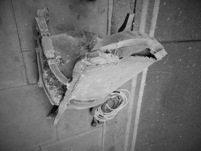 broken-armchair-on-the-street-bw