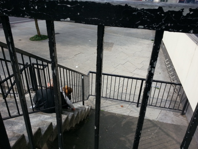 two-people-sitting-on-the-stairs-at-elephant-and-castle